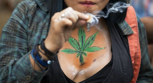 A young woman smokes marijuana at a recent legalization rally in Mexico City. (PHOTO: sandiegouniontribune.com)