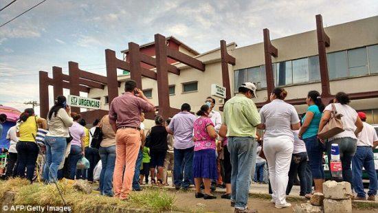 Victims' families wait for news outside Veracruz hospital. (PHOTO: AFP/Getty Images)