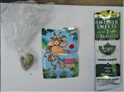 "Synthetic marijuana, ""Spice,"" confiscated by Daleville investigators recently. The potpourri substance, along with the package it came in—marketed as a  ""botanical sachet"" and called ""Crazy Monkey"" along with a pack of cigarillos, used to smoke the illegal substance. A plastic soft drink bottle was also in the evidence bag and was used as a bong."