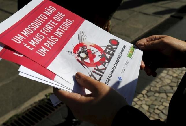 A Brazilian Army soldier shows pamphlets during the National Day of Mobilization Zika Zero in Rio de Janeiro, Brazil, February 13, 2016. REUTERS/Sergio Moraes