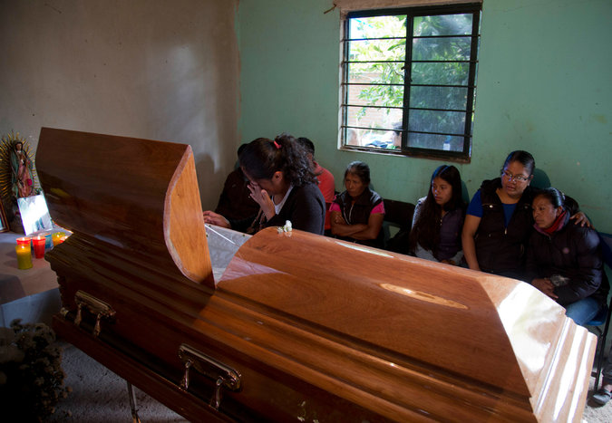 A woman mourning at the coffin of Yalid Jimenez, 29, who died on June 19 in the clashes in Nochixtlán, Mexico. (PHOTO: Eduardo Verdugo/Associated Press)