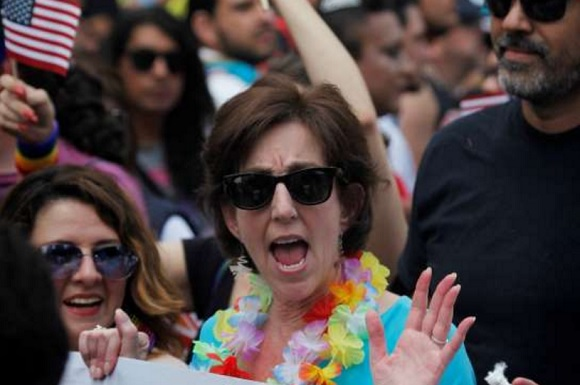 Roberta Jacobson, U.S. ambassador in Mexico, waves while marching in Mexico City's gay pride parade, Saturday, June 25, 2016. Thousands of people marched down Paseo de la Reforma for one of the largest gay pride events in Latin America. (AP Photo/Marco Ugarte)