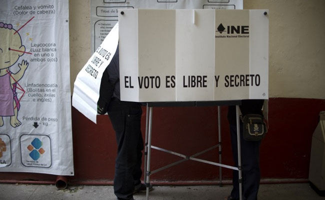 Citizens voting in 7 of 12 states that held governor elections Sunday showed strong discontent with the ruling PRI party. (PHOTO: AFP)