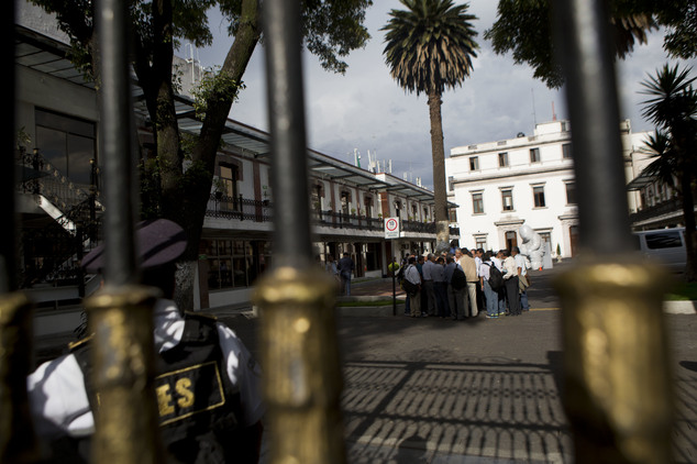 Protesting teachers, accompanied by a mediation commission, huddle together in discussion inside the courtyard of the Interior Ministry, as they await the start of a meeting with Secretary of the Interior Miguel Angel Osorio Chong, in Mexico City, Wednesday, June 22, 2016. The negotiations between the striking radical teachers and the government come three days after a clash between protestors and police in Oaxaca state left eight dead. Though who started shooting is disputed, journalists filmed police firing their weapons in the confrontation, which also left more than 100 injured. (AP Photo/Rebecca Blackwell)