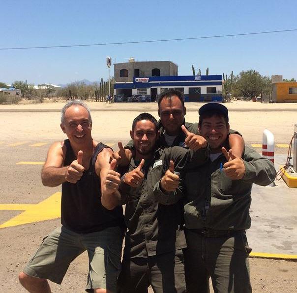 Chuck Bolotin with Pemex attendants in Baja California Sur. (PHOTO: courtesy Chuck Bolotin)