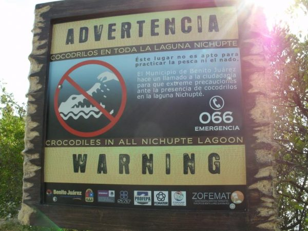 Warning signs advise of crocodiles along Boulevard Kukulkan.(PHOTO: geocaching.com)