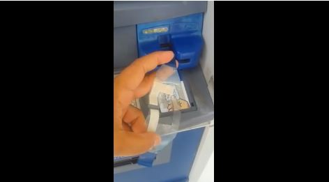 Frame from video purportedly reveals ATM card cloning. (PHOTO: yucatan.com.mx)