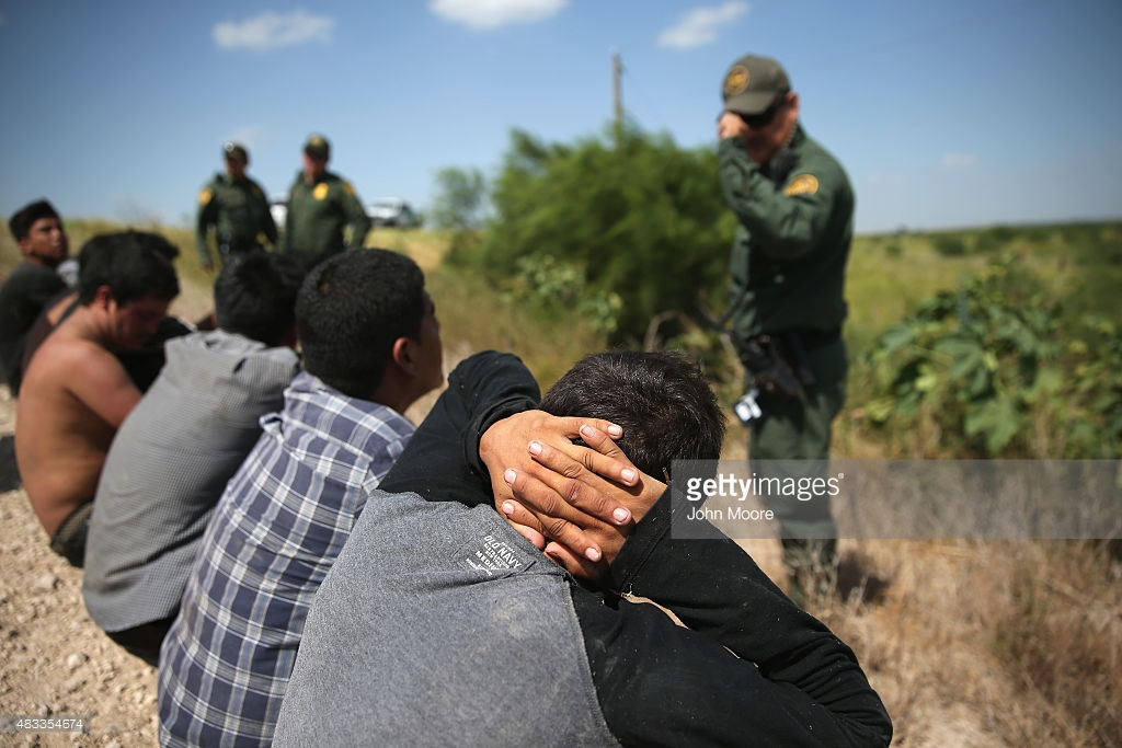 U.S. Border Patrol agents detain undocumented immigrants after they crossed the border from Mexico into the U.S. (PHOTO: gettyimages.com)