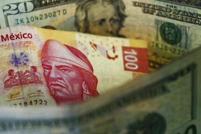 A picture illustration shows Mexican pesos and U.S. dollars banknotes in Mexico City March 10, 2015. REUTERS/Edgard Garrido