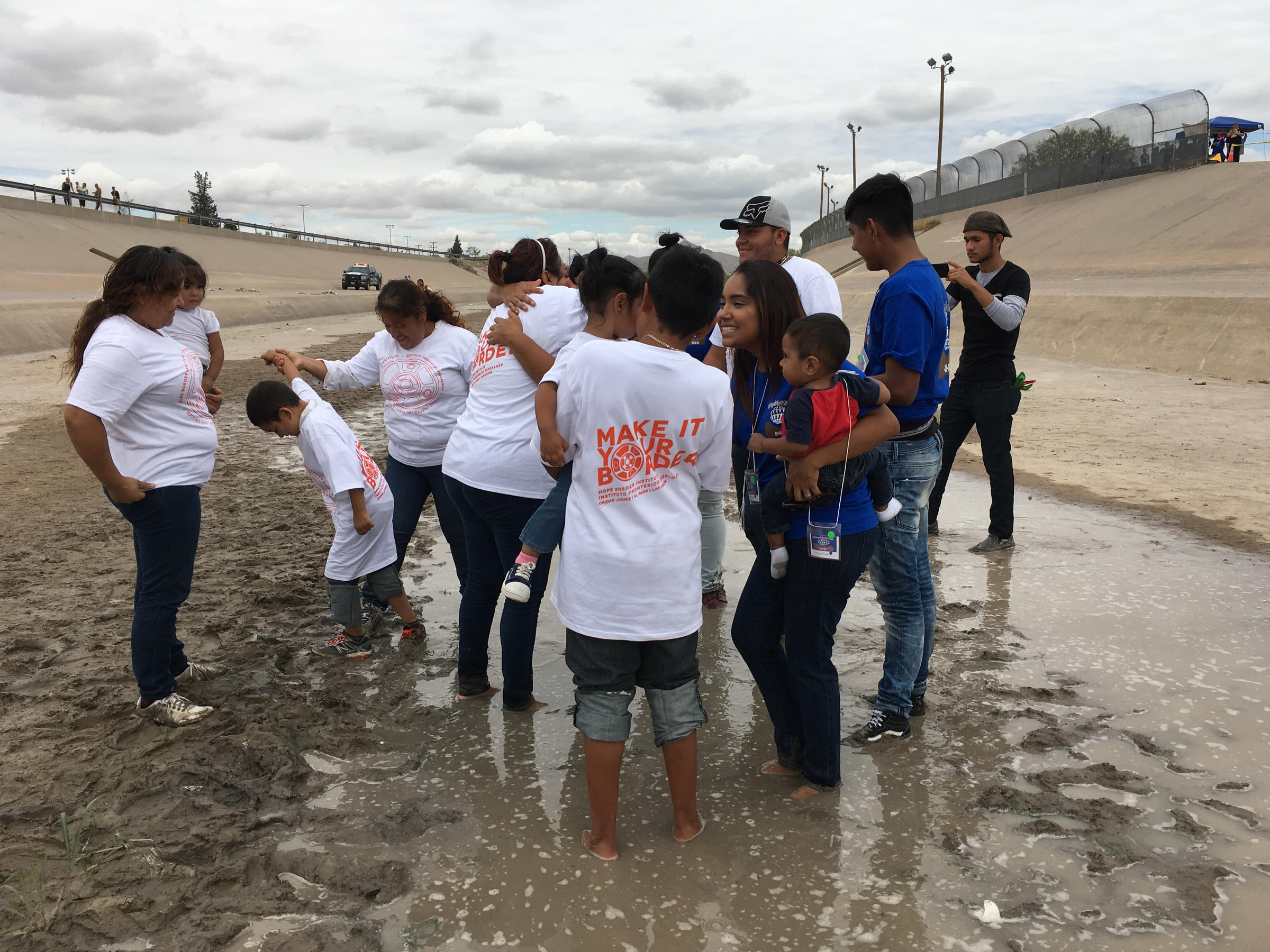 Families were reunited briefly in the Rio Grande River Wednesday Aug. 10. (PHOTO: krwg.org)