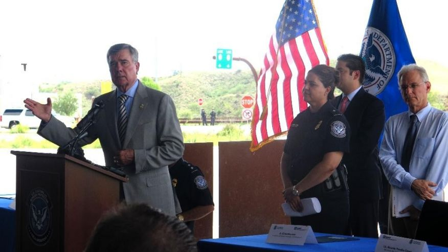 U.S. Customs and Border Protection Commissioner Gil Kerlikowske, left, speaks during an event in Nogales, Ariz., on Thursday, Aug. 4, 2016, promoting a new program that allows Mexican and American customs officers to jointly inspect cargo trucks headed north bound. Kerlikowske said the pilot program has already reduced wait times from two to three hours to 25 minutes in the week that the program has been used. Only select companies are allowed to participate. (AP Photo/Astrid Galv'n) (The Associated Press)