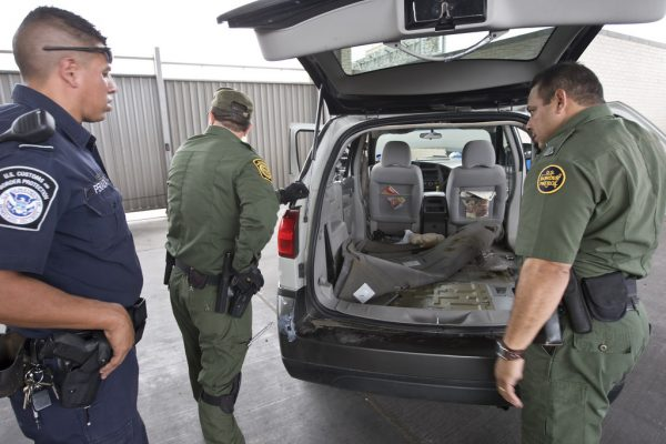 Agents inspect vehicle at U.S. border. (PHOTO: CPB Photography)