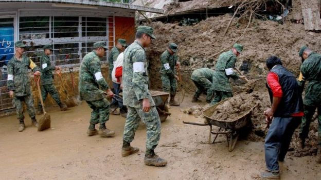 Mexico army troops are helping in rescue and recovery efforts in the wake of Tropical Storm Earl. (PHOTO: AFP)