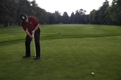 A golfer putts at the historic Mexico City club where a tournament is moving from a Florida course owned by Donald Trump. (PHOTO: ap.org)