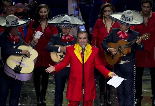 In this Feb. 29, 2012, file photo, Mexican singer Juan Gabriel, front, performs during an event honoring Mexican comedian Roberto Gomez Bolanos, popularly known as Chespirito, at the National Auditorium in Mexico City (Photo: AP)