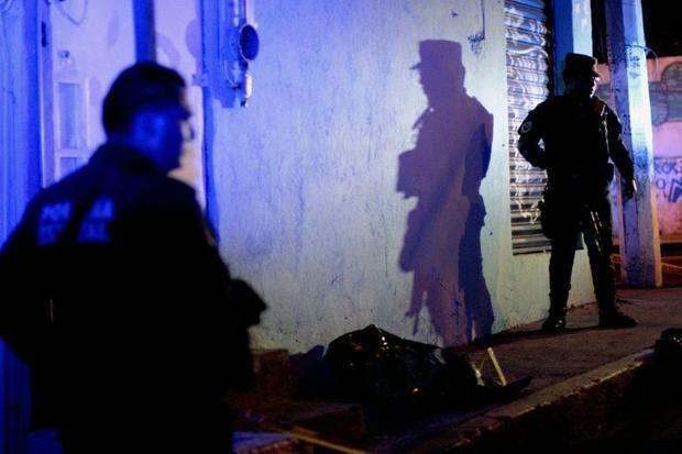 (PHOTO: file) Investigators at murder scene.