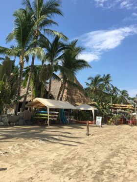 sayulita_beach_with_surf_boards_stored-1