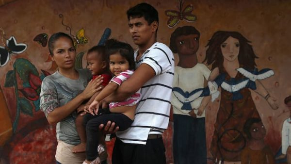 A family of immigrants arrives from Honduras to a shelter for undocumented immigrants in Tenosique, Mexico. (PHOTO: ft.com)