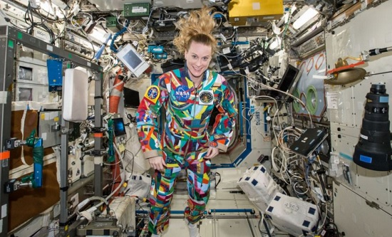 An undated handout photo from NASA shows astronaut Kate Rubins aboard the International Space Station wearing a hand-painted spacesuit decorated by childhood cancer patients at the University of Texas MD Anderson Cancer Center in Houston. (Photo: AP)