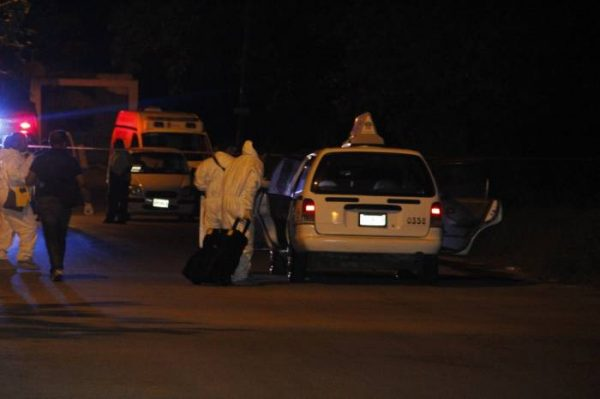 Authorities investigated the scene after finding the body of one of the murdered taxi drivers. (PHOTO: sipse.com)