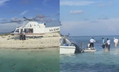 Photo shows VIPs boarding yacht after helicopter landing at Scorpion Reef. (PHOTO: 24-horas.com)