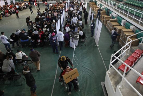 People receive free television sets in Ciudad Juárez in January 2015. PHOTO: REUTERS