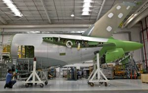Bombardier employees work on an aft fuselage at the company's plant in Queretaro, Mexico(PHOTO: mcclatchy.com)