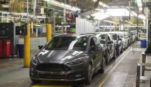A lineup of Ford Focus vehicles on an assembly line in Wayne, Michigan. (Photo: SAUL LOEB/AFP/Getty Images)