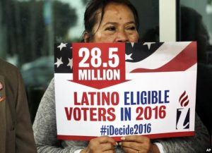 Georgina Arcienegas holds a sign in support of Latino voters in Florida earlier this year. PHOTO: VOA news)
