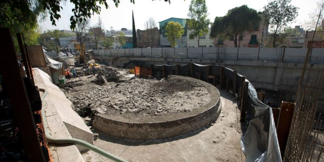 A view of a temple found in Mexico City, Wednesday Nov. 30, 2016. The circular platform, about 36 feet in diameter and four feet tall, now sits in the shadow of a shopping mall under construction. But the site believed to be built to worship the god of wind, Ehecatl-Quetzalcoatl, was deemed valuable enough to preserve. (AP Photo/Eduardo Verdugo)