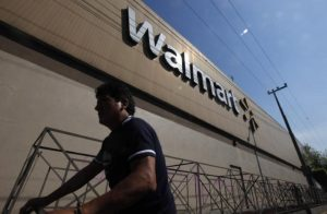 A person walks outside a Wal-Mart store in Mexico City. PHOTO: REUTERS/Edgard Garrido