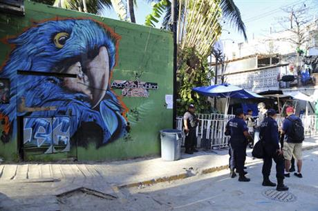 Police guard the entrance to the Blue Parrot nightclub after shooting Monday Jan. 16. (PHOTO: ap.org)