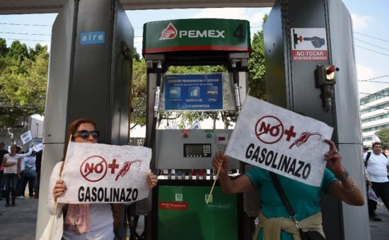 Protesters decry gas prize hikes in Mexico City. (PHOTO: AFP)