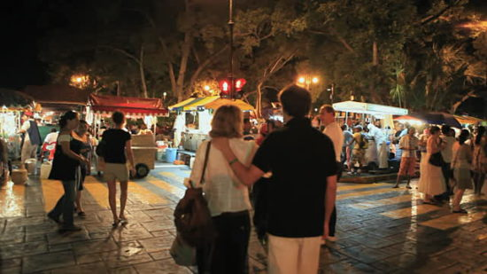 Tourists gather amid vendors in Merida's Plaza Grande. (PHOTO: Getty Images)