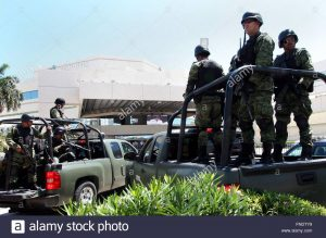 Mexican soldiers stand guard in Cancun in this file photo. PHOTO: EPA/ELIZABETH RUIZ