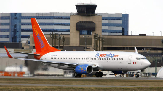 A Boeing 737 (737-800) jetliner belonging to Sunwing Airlines takes off from Calgary, Alberta. (PHOTO: Larry MacDougal/TCPI/The Canadian Press