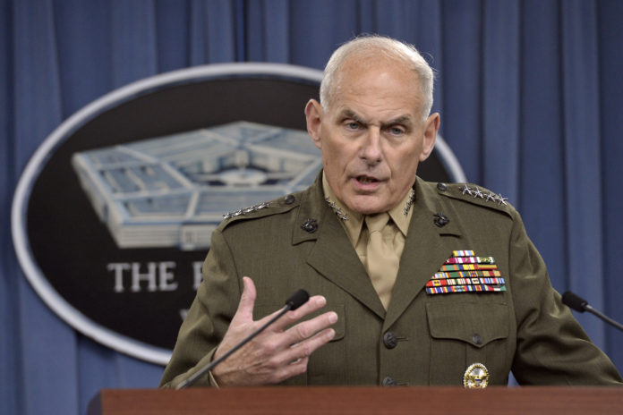 U.S. Southern Command Commander Marine Corps Gen. John F. Kelly briefs the media on the latest developments in his command's efforts to stem the flow of drugs from South and Central America in the Pentagon Press Briefing Room, March 13, 2014. DoD Photo by Glenn Fawcett (Released)