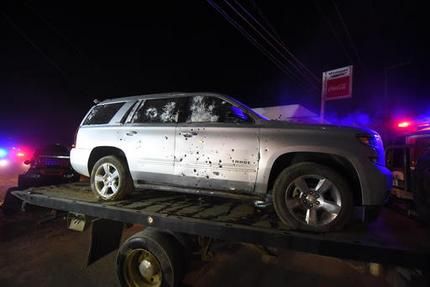 A bullet ridden sports utility vehicle is taken away by authorities after a gun battle with Mexican Marines in which a suspect identified by authorities as the leader of the Beltran Leyva cartel, Juan Francisco Patron Sanchez and several accomplices died in the exchange, in Tepic, Nayarit state, Mexico, early Friday, Feb. 10, 2017. The Interior Department said that Juan Francisco Patron Sanchez headed up the cartel's operations in the state of Nayarit and in the southern part of Jalisco state. (AP Photo/Chris Arias)