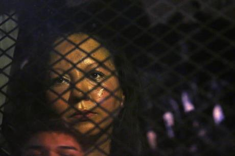 A woman whose probable deportation sparked protests in Phoenix is seen in a security vehicle. (PHOTO: Arizona Republic via AP)