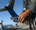 An undocumented immigrant prepares to board a deportation flight to Guatemala in Mesa, Arizona.(PHOTO: cnn.com)
