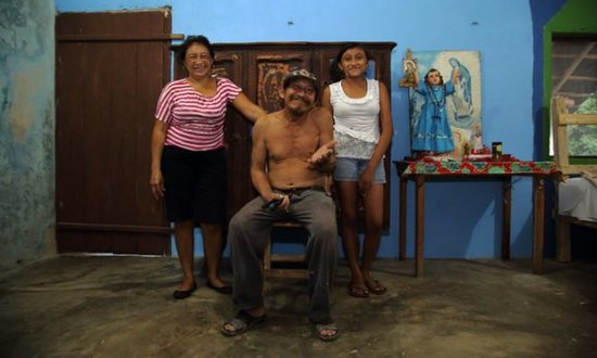 Juanito with his sister and granddaughter in the village of Takkbil'Ja. (Photo: Kevin Rushby for the Guardian)