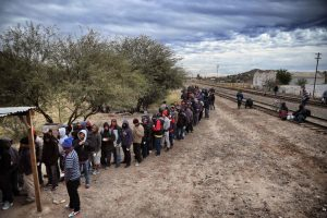 Migrants waiting for food at the Community Center for Migrant Assistance in Caborca, Sonora. PHOTO: Alfredo Estrella/Agence France-Presse — Getty Images