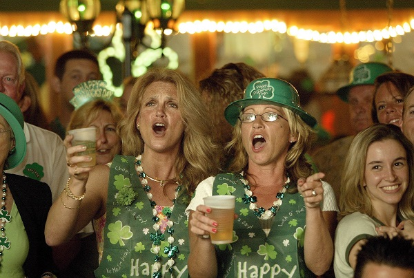 """03172003 WEST PALM BEACH - Friends Donna Shea, left, of Port Charlotte, and Marla Guthrie, right, of Wellington, sing along with the band Innisfree during a St. Patrick's Day celebration at O'Shea's Irish Pub in downtown West Palm Beach Monday night.  Clematis street was blocked off in front of O'Shea's to accomodate a beer tent:  bagpipers, Irish dancing, Corn Beef and Cabbage and """"Guinness, Guinness and more Guinness"""" was featured.  PHOTO BY:  RICHARD GRAULICH. ORG XMIT:   ORG XMIT: MER0709061529514369"""