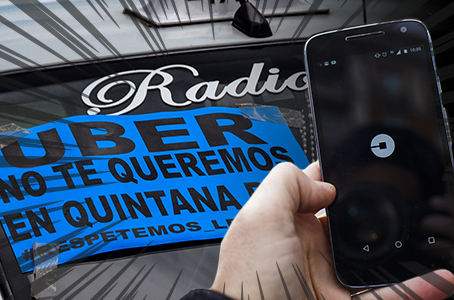 """A flyer on a taxi windshield reads: """"Uber we don´t want you in Quintana Roo."""" (PHOTO: elfinanciero.com)"""