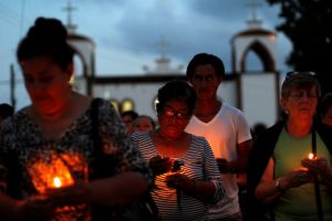 Mothers of missing sons came out of a service of Pedro Alberto Huesca, whose remains were found at one of the unmarked graves where skulls were found on a plot of land, in Palmas de Abajo, Veracruz, Mexico March 16, 2017. PHOTO: REUTERS/Carlos Jasso