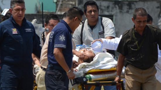Wounded journalist Armando Arrieta Granados is transported to the hospital. (PHOTO: El Clarin)