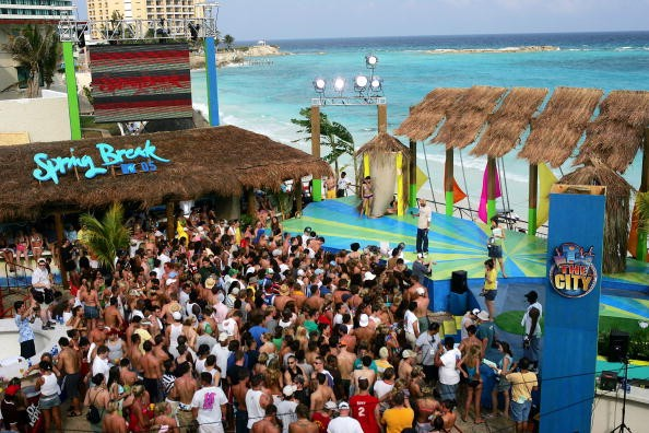 A crowd gathers in front of the stage during a taping for MTV Spring Break on the beach at The City nightclub March 8, 2005 in Cancun, Mexico. (Photo: Scott Gries/Getty Images