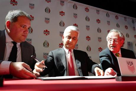 Victor Montagliani, left, President of the Canadian Soccer Association, Sunil Gulati, center, President of the United States Soccer Federation, and Decio de Maria, President of the Mexican Football Federation, sign the document of intent to FIFA seeking to co-host the 2026 World Cup, Monday, April 10, 2017, in New York (PHOTO: (AP Photo/Mark Lennihan)