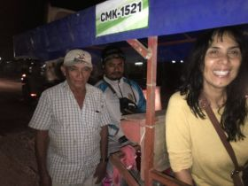 The writer's wife in trici-taxi in Merida. (PHOTO: Chuck Bolotin)