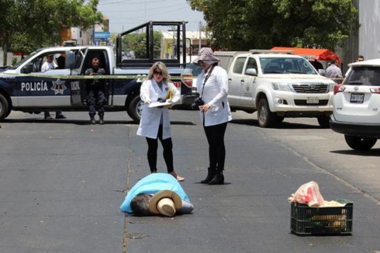 Javier Valdez' body was examined by authorities. (PHOTO: Reuters)